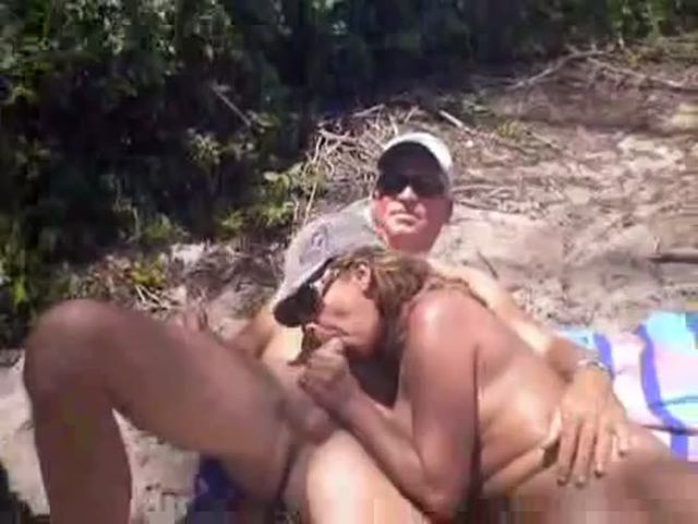 Horn girl firend having blow job in public beach on a vacation